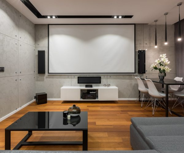 Home interior with projector screen, modern table and white chairs